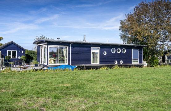 Luxe split-levelwoonark met zelfstandig guesthouse in Wilnis